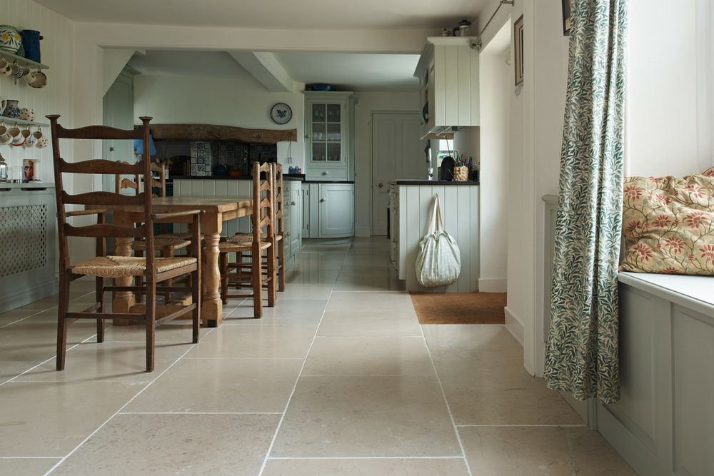 Charming country house kitchen with limestone flooring and window seating