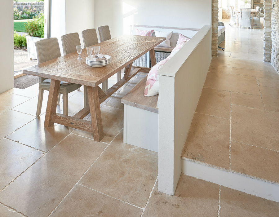 Beige Limestone Flooring in dining space