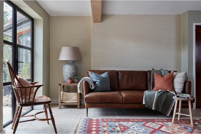 country style living room with large doors to garden